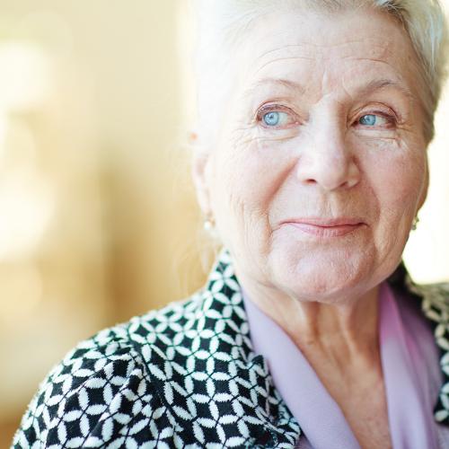 Elderly retired woman smiling.
