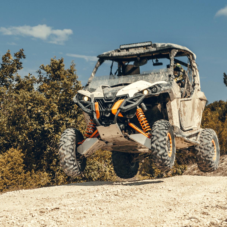 ATV going off a jump.