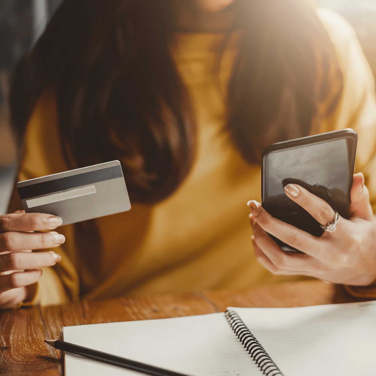 Woman using her phone as a credit card.