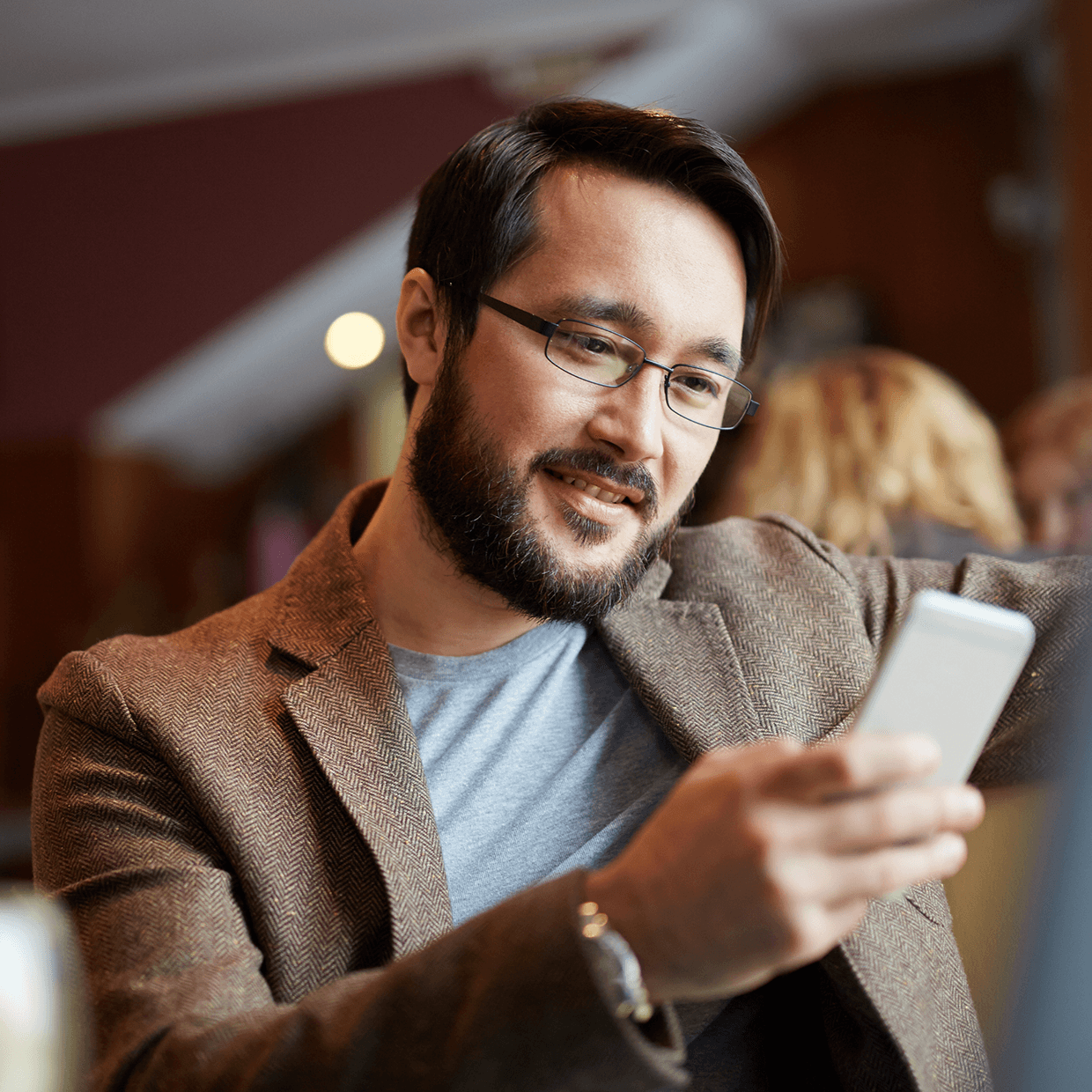 Man looking at his accounts on a cell phone.